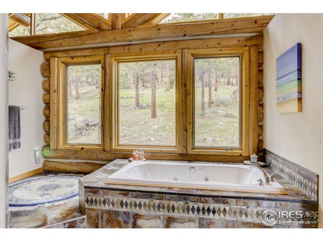 Master Bath w/ views of forest