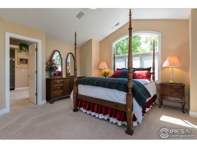Master bedroom with sitting area, fireplace, deck