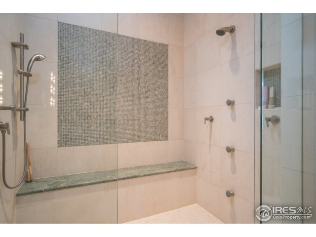 Limestone & marble shower w/curb-less shower