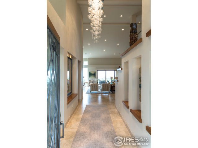 Hand blown, glass chandelier accentuates entryway
