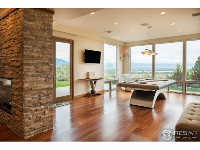 Game room w/sweeping views & stone fireplace