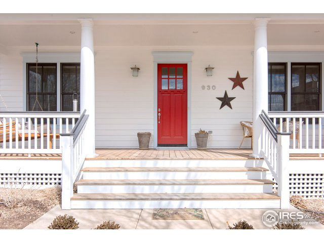 Warm and inviting wraparound front porch