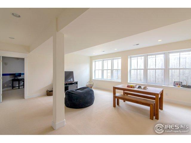 Basement rec. room w/wall of windows!
