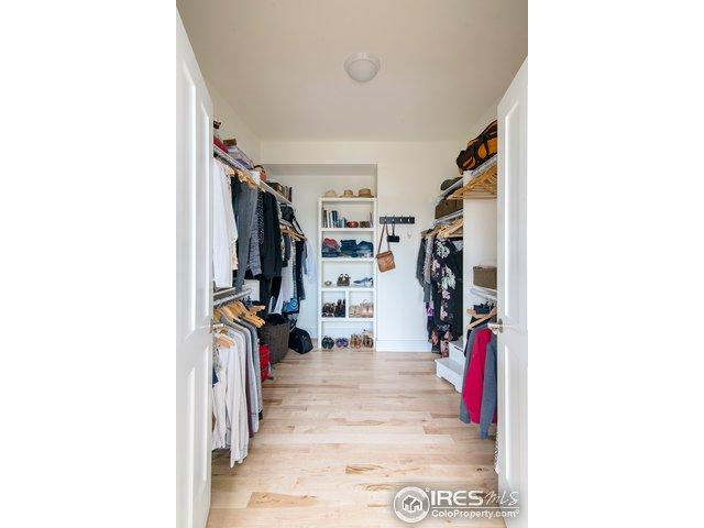 large walk in closet in master bedroom