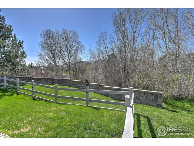 Stone wall included in property and vinyl fence