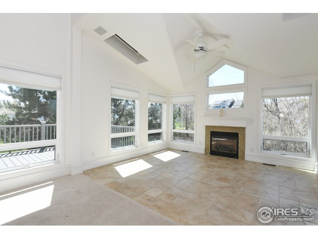 Spacious main floor overlooking deck, windows!