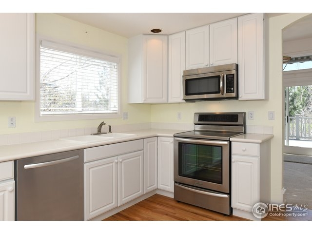 Upgraded stainless appliances, bright kitchen