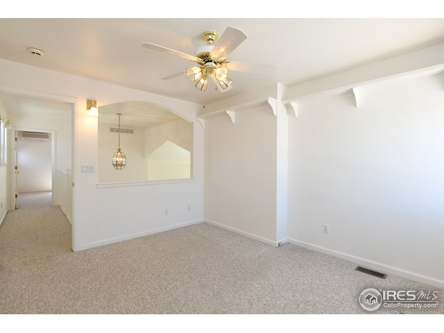 Upper loft from study with ceiling fan.