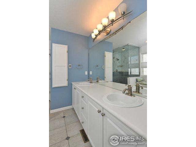 Master vanity, steam shower, radiant heat flrs