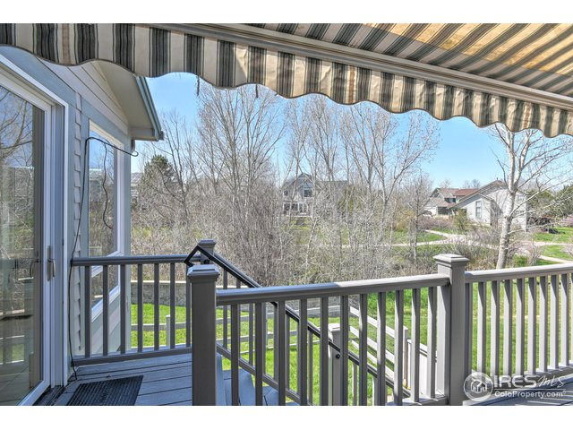 Large trex deck upgraded with retractable awning