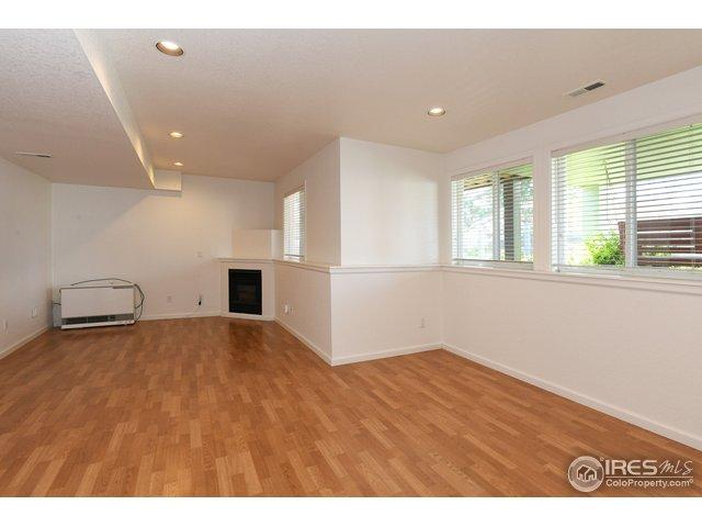 Garden lvl basement rec room, w/ fp, vinyl floors