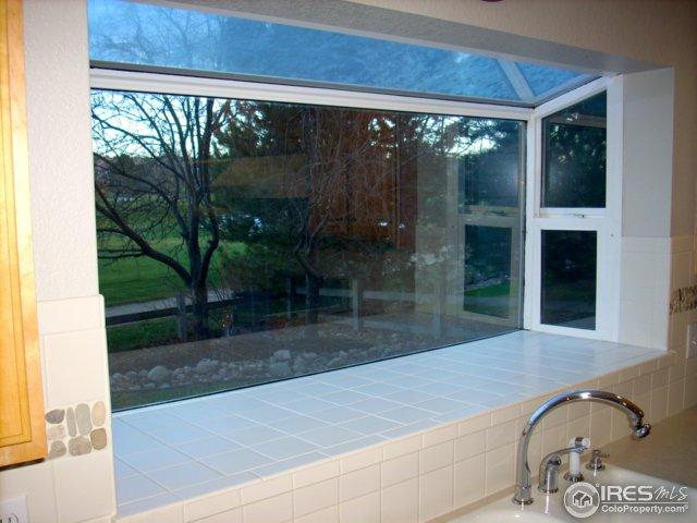 Greenhouse window above kitchen sink