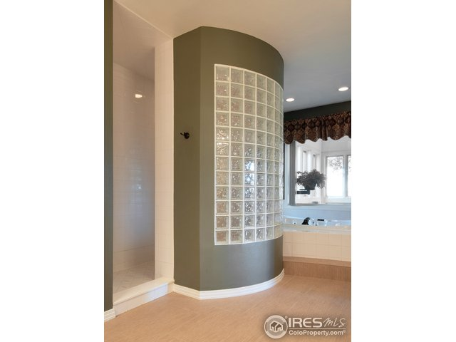 Walk in shower and glass wall, lots of light