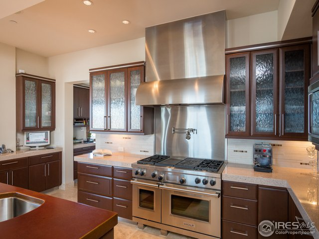 Caesarstone and 3-inch concrete-leathered counters