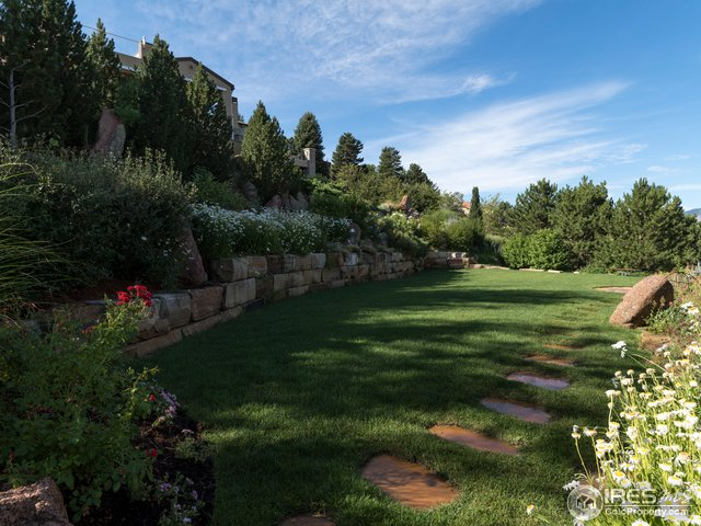 Tiered yard w/spectacular gardens & fruit trees