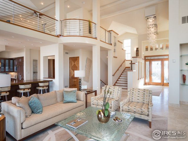2-story ceilings, custom hand-forged front door.