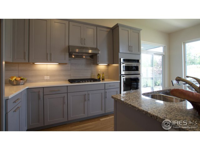 Open kitchen with double ovens and cooktop example