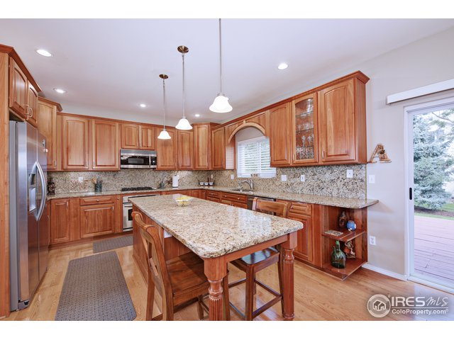 Cherry cabinetry, granite counters, pendant lights