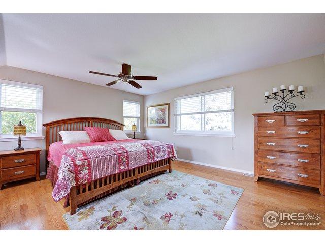Master bedroom has ceiling fan & hardwood floors