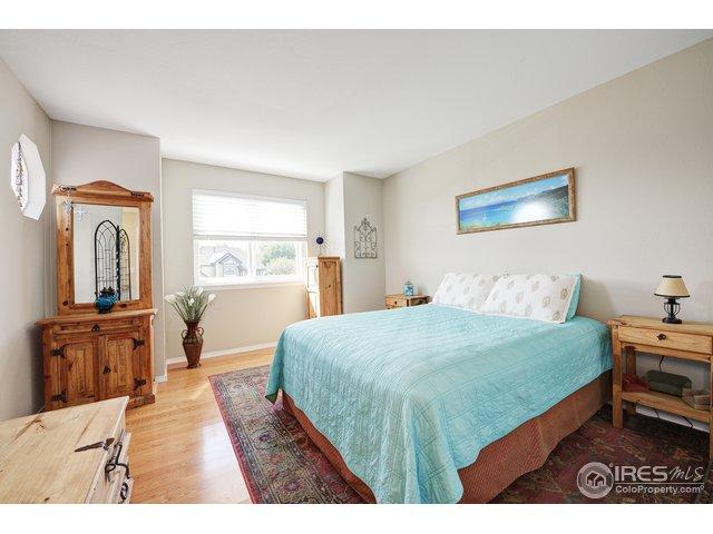 Bdrm #2 has wood floors, private vanity sink