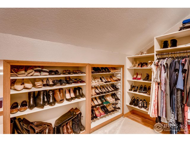Walk-in master closet with built in shelving