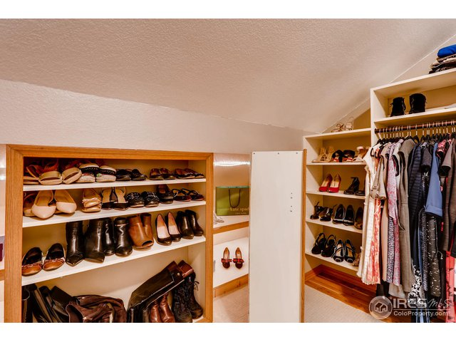 LOOK! THAT SHOE WALL OPENS TO REVEAL MORE STORAGE!