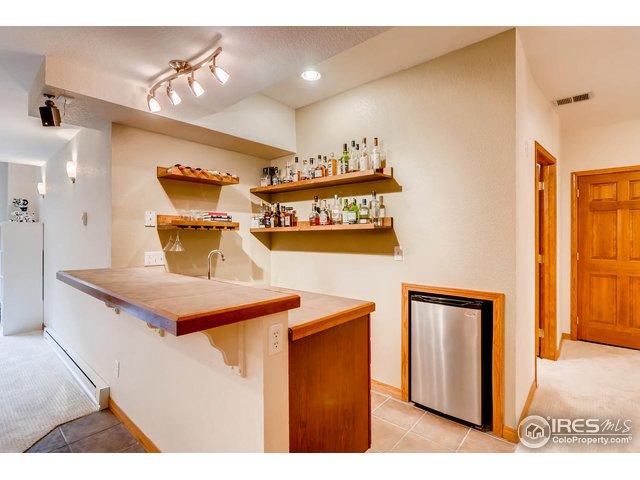 Wet bar, basement, refrigerator.