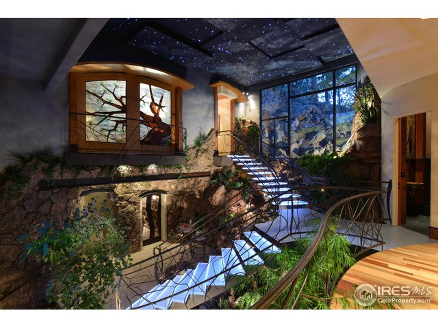 A ONE-OF-A -KIND INDOOR GARDEN WITH WATERFALL