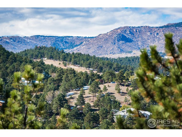 EXPANSIVE VIEWS OF SURROUNDING PINE BROOK HILLS