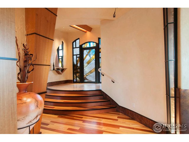 RAISED ENTRY WITH RECLAIMED RAILROAD TILE FLOORS