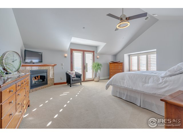 Master bedroom w/ cozy fireplace & natural light.