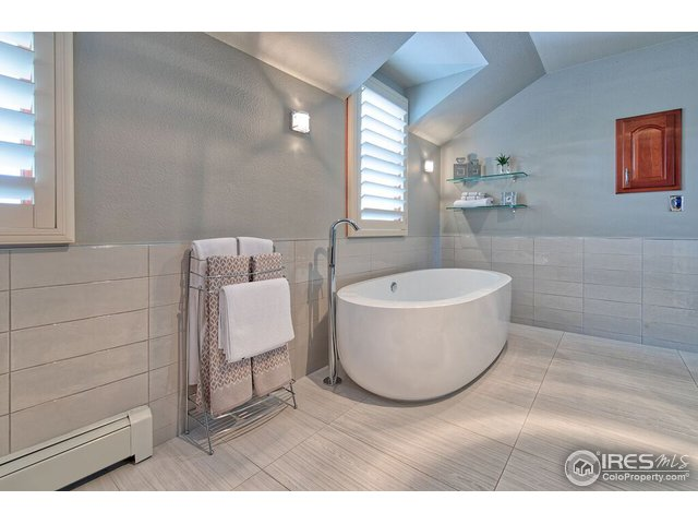 Luxurious master bath in a soothing gray palette.