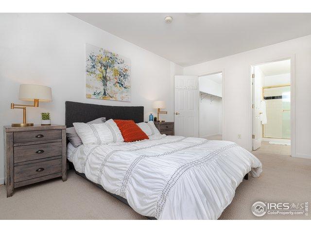 Clean & cozy master bedroom with walk-in closet.