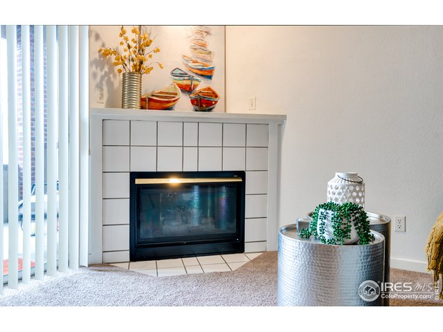 Cozy fireplace in living room.