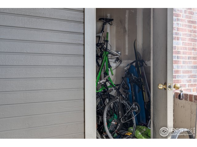 Storage unit off patio for bikes/skis/gear/toys.