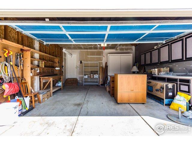 roomy garage w/ workbenches, storage, & 80a line