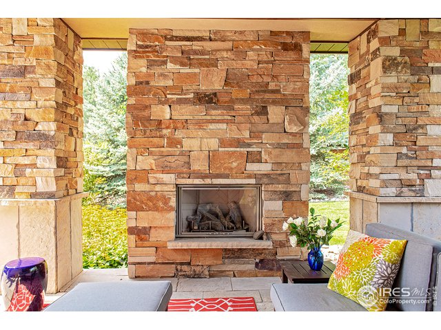 Covered patio stone gas fireplace+ outdoor kitchen